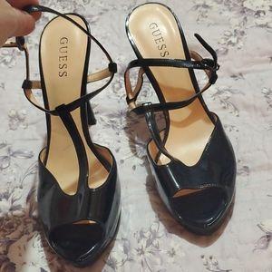 Black Guess T-straps heels.